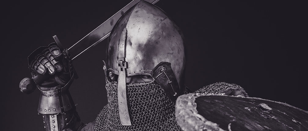 Knight in armor with sword and shield