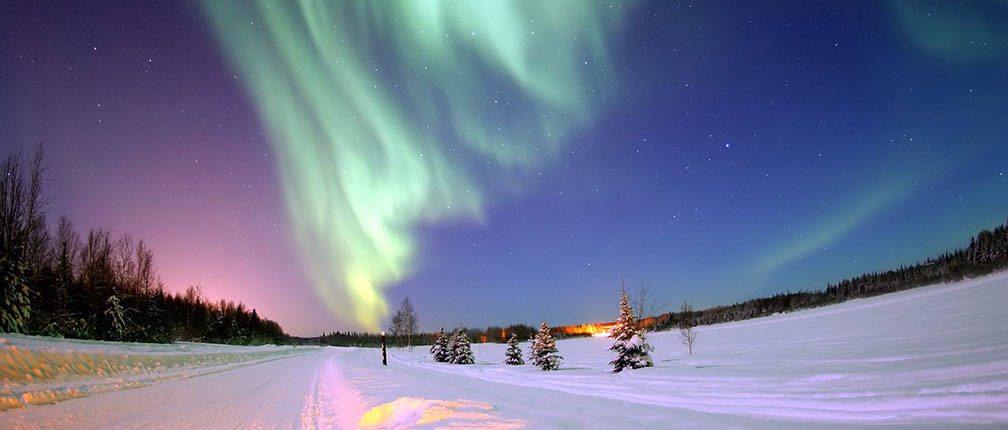 The Aurora Borealis, or Northern Lights, shines above Bear Lake, Alaska.